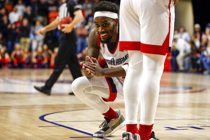 South Alabama guard Andre Fox (22) reacts after Auburn forward Isaac Okoro (23) hits the go ahead shot during the second half of an NCAA college basketball game, Tuesday, Nov. 12, 2019, in Mobile, Ala. Auburn won 70-69. (AP Photo/Butch Dill)