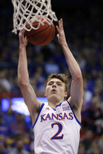 Kansas guard Christian Braun (2) makes a basket after a steal during the first half of an NCAA college basketball game against Iowa State in Lawrence, Kan., Monday, Feb. 17, 2020. (AP Photo/Orlin Wagner)