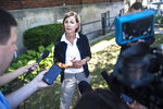 Iowa Gov. Kim Reynolds talks to the media after signing a sweeping tax cut package that cuts income and property taxes, eliminates the inheritance tax and realigns the state's mental health funding system, on Wednesday, June, 16, 2021, at YSS, in Ames, Iowa. (Kelsey Kremer/The Des Moines Register via AP)