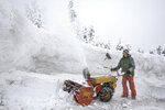 Andy Richmond clears snow off his driveway, Thursday, March 7, 2019, in Frisco, Colo. (Hugh Carey/Summit Daily News via AP)