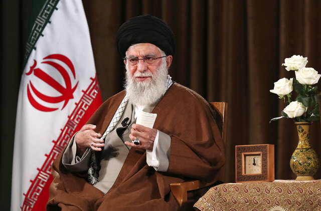 In this picture released by the official website of the office of the Iranian supreme leader, Supreme Leader Ayatollah Ali Khamenei addresses the nation on a televised speech, in Tehran, Iran, Sunday, March 22, 2020. Iran's supreme leader Sunday refused U.S. assistance to fight the new coronavirus, citing an unfounded conspiracy theory that the virus could be man-made by America. (Office of the Iranian Supreme Leader via AP)