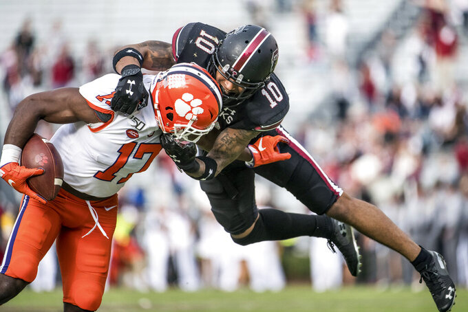 South Carolina defensive back R.J. Roderick (10) tackles Clemson wide receiver Cornell Powell (17) during the second half of an NCAA college football game Saturday, Nov. 30, 2019, in Columbia, S.C. Clemson defeated South Carolina 38-3. (AP Photo/Sean Rayford)