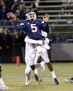 Connecticut quarterback David Pindell (5) is sacked during the first half of an NCAA college football game against Temple, Saturday, Nov. 24, 2018, in East Hartford, Conn. (AP Photo/Stephen Dunn)
