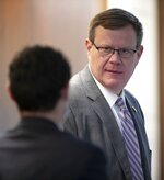North Carolina House Speaker Tim Moore confers with Principal Clerk James White on Wednesday, July 8, 2020 at the General Assembly in Raleigh, N.C.  (Robert Willett/The News & Observer via AP)