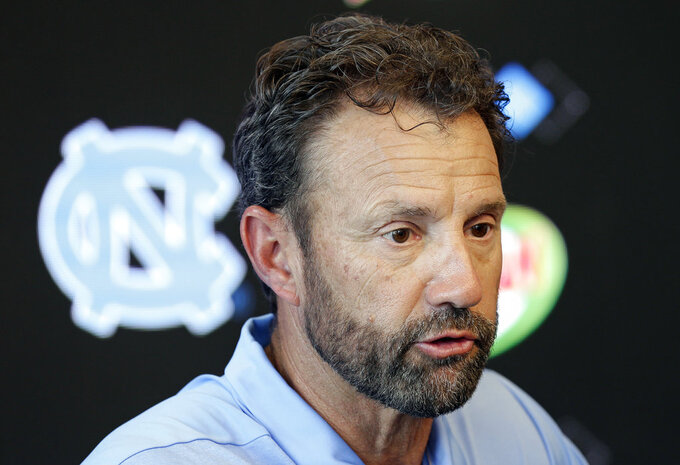 North Carolina coach Larry Fedora makes comments during the NCAA college football team's media day in Chapel Hill, N.C., Monday, Aug. 6, 2018. Following an NCAA violation involving the sale of team-issued shoes, the university announced today that 13 football players will miss games during the 2018 season. (AP Photo/Gerry Broome)
