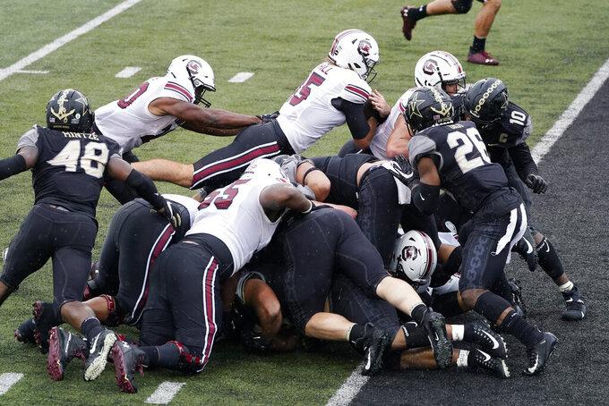 South Carolina quarterback Collin Hill (15) dives over the goal line for a 1-yard touchdown run against Vanderbilt in the first half of an NCAA college football game Saturday, Oct. 10, 2020, in Nashville, Tenn. (AP Photo/Mark Humphrey)