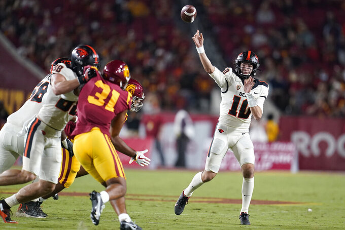 Oregon State quarterback Chance Nolan throws a touchdown pass to tight end Teagan Quitoriano during the first half of an NCAA college football game against Southern California Saturday, Sept. 25, 2021, in Los Angeles. (AP Photo/Marcio Jose Sanchez)