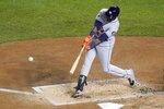 Houston Astros' Yordan Alvarez hits a two-run home run during the second inning of Game 5 of the baseball World Series against the Washington Nationals Sunday, Oct. 27, 2019, in Washington. (AP Photo/Pablo Martinez Monsivais)