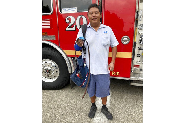 This photo provided by the Los Angeles County Sheriff's Office shows U.S. Postal Service mailman Fernando Garcia. While on his route in Southern California, Garcia came to the rescue of a man who accidentally cut his own arm with a chainsaw late last week, authorities said.  Garcia said he found a man with a cut to the arm and used his belt as a tourniquet. He stayed with the man until an ambulance arrived. ( Los Angeles County Sheriff's Office via AP)