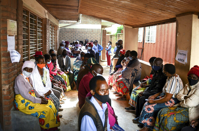 People wait to receive the AstraZeneca COVID-19 vaccine at Ndirande Health Centre in Blantyre Malawi, Monday, March 29, 2021. Malawi is vaccinating health care workers, elderly and those with health conditions that put them at higher risk of severe COVID-19, using the AstraZeneca doses that arrived early in March. (AP Photo/Thoko Chikondi)