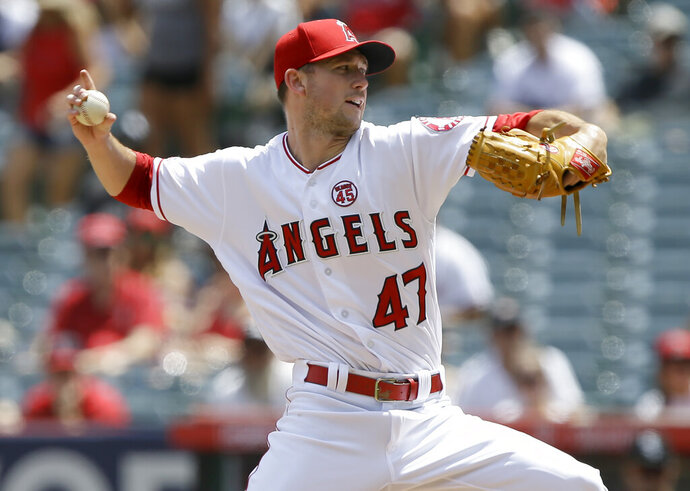 Los Angeles Angels starting pitcher Griffin Canning throws to a Chicago White Sox batter during the first inning of a baseball game in Anaheim, Calif., Sunday, Aug. 18, 2019. (AP Photo/Alex Gallardo)