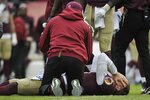FILE - Washington Redskins quarterback Alex Smith, bottom, reacts after an injury during the second half of an NFL football game against the Houston Texans in Landover, Md., in this Sunday, Nov. 18, 2018, file photo. Smith announced his retirement Monday, April 19, 2021, on Instagram, saying he still has plenty of snaps left him just shy of his 37th birthday but is calling it quits to enjoy time with his family. Smith earned AP Comeback Player of the Year honors for getting back on the field last season, two years removed from his gruesome injury that required 17 surgeries to repair. (AP Photo/Mark Tenally, File)