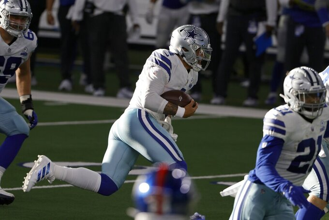 Dallas Cowboys quarterback Dak Prescott (4) runs the ball in the second half of an NFL football game against the New York Giants in Arlington, Texas, Sunday, Oct. 11, 2020. Prescott suffered a right lower leg injury on the play and was carted off the field by medical personnel. (AP Photo/Ron Jenkins)