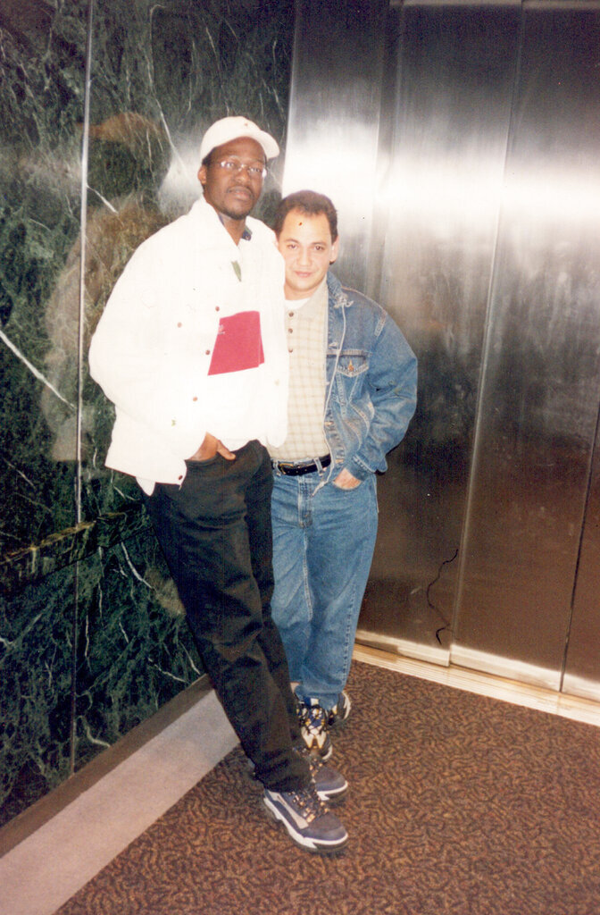 This undated photo provided by Sekou Siby shows Sekou Siby with Isidro Ottenwalder, a coworker of his who died on 9/11. Twenty years after 9/11, Sekou Siby still feels the pangs of survivor's guilt. A cook and dishwasher at the World Trade Center's Windows on the World restaurant, Siby had swapped shifts with a co-worker that day, who ended up dying in the terrorist attacks. (Restaurant Opportunities Centers via AP)