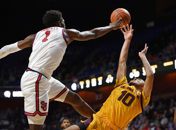 St. John's Josh Roberts blocks a shot attempt by Arizona State's Jaelen House, right, during the first half of an NCAA college basketball game, Saturday, Nov. 23, 2019, in Uncasville, Conn. (AP Photo/Jessica Hill)