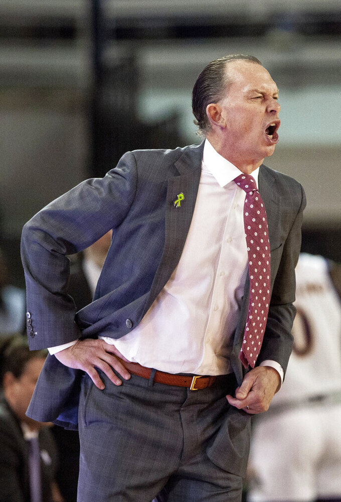 East Carolina head coach Joe Dooley shouts at a referee moments before being ejected during the second half of an NCAA college basketball game against Houston in Greenville, N.C., Wednesday, Feb. 27, 2019.