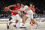 Indiana forward Jerome Hunter (21) pushes a loose ball away from Connecticut guard James Bouknight (2) near the Connecticut basket during the first half of an NCAA college basketball game in the Jimmy V Classic, Tuesday, Dec. 10, 2019, in New York. (AP Photo/Kathy Willens)