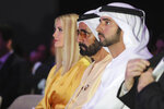 From left to right, Ivanka Trump, the daughter and senior adviser to U.S. President Donald Trump, Sheikh Mohammed bin Rashid Al Maktoum, Vice President and Prime Minister of the United Arab Emirates and ruler of Dubai and Dubai Crown Prince, Sheikh Hamdan bin Mohammed bin Rashid Al Maktoum, attend the Global Women's Forum in Dubai, United Arab Emirates, Sunday, Feb. 16, 2020. (AP Photo/Kamran Jebreili)