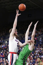 Gonzaga forward Drew Timme, left, shoots over North Dakota forward Kienan Walter during the first half of an NCAA college basketball game in Spokane, Wash., Tuesday, Nov. 12, 2019. (AP Photo/Young Kwak)