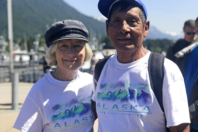 """This July 2019 photo provided by Miguel Gonzalez, shows Margrit and Lucio Gonzalez in Alaska. The Gonzalez family is suing Princess Cruises and owner Carnival Corp. for negligence and wrongful death — one of dozens of lawsuits by passengers and surviving relatives. Lucio Gonzalez died of coronavirus.""""They put him on a ventilator for three weeks and two days, and after that he died,"""" his widow said. """"I never saw him alive again.""""  (Miguel Gonzalez via AP)"""