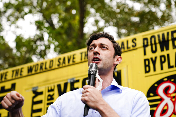 """Democratic candidate for Senate Jon Ossoff speaks to a crowd during a """"Get Out the Early Vote"""" event at the SluttyVegan ATL restaurant on Tuesday, Oct. 27, 2020, in Jonesboro, Ga. (AP Photo/Brynn Anderson)"""
