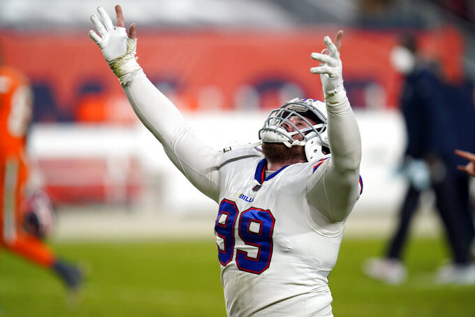Buffalo Bills defensive tackle Harrison Phillips reacts after the Bills defeated the Denver Broncos in an NFL football game Saturday, Dec. 19, 2020, in Denver. (AP Photo/David Zalubowski)