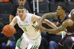 Oregon's Payton Pritchard, left, steals the ball from Texas Southern's Tyrik Armstrong during the first half of an NCAA college basketball game in Eugene, Ore., Saturday, Dec. 21, 2019. (AP Photo/Chris Pietsch)