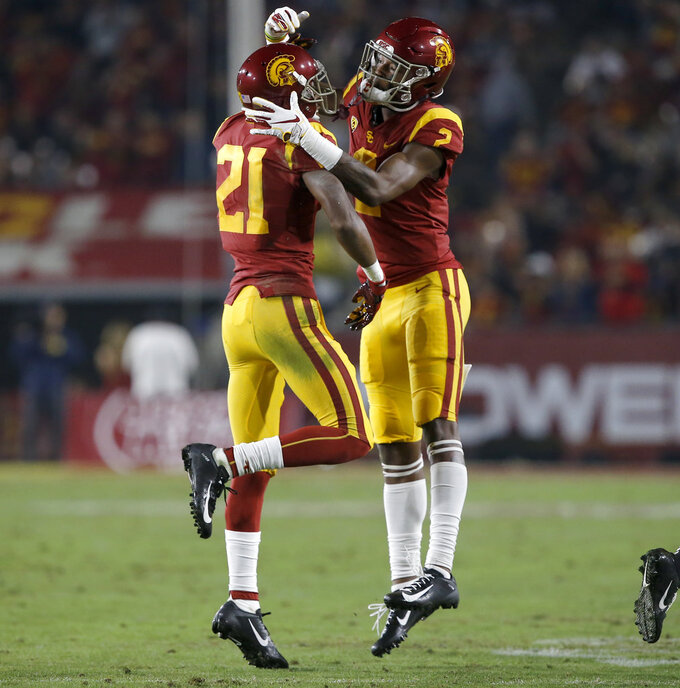 Southern California wide receiver Tyler Vaughns, left, celebrates his touchdown catch with wide receiver Devon Williams, right, during the first half of an NCAA college football game against California in Los Angeles, Saturday, Nov. 10, 2018. (AP Photo/Alex Gallardo)