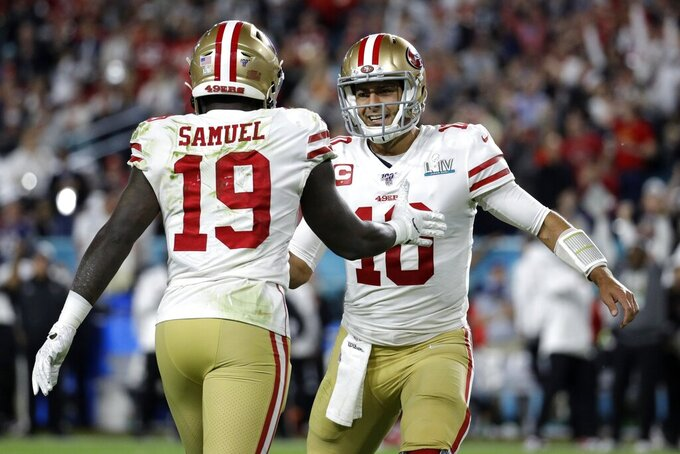 San Francisco 49ers' Deebo Samuel (19) celebrates with quarterback Jimmy Garoppolo (10) during the first half of the NFL Super Bowl 54 football game against the Kansas City Chiefs Sunday, Feb. 2, 2020, in Miami Gardens, Fla. (AP Photo/Patrick Semansky)