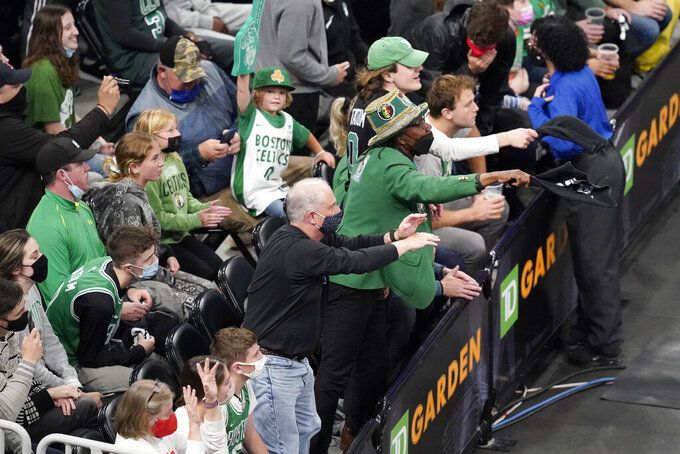 Fans make noise to distract Brooklyn Nets guard Kyrie Irving (11) as he shoots a free throw in the first quarter of Game 4 against the Boston Celtics during an NBA basketball first-round playoff series, Sunday, May 30, 2021, in Boston. (AP Photo/Elise Amendola)