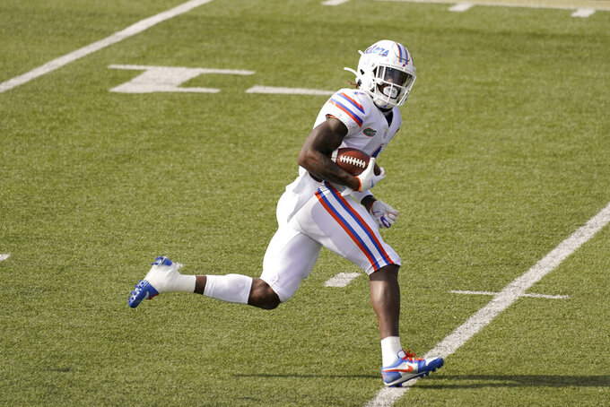 Florida wide receiver Kadarius Toney (1) runs a 27-yard pass reception for a touchdown against Vanderbilt in the first half of an NCAA college football game Saturday, Nov. 21, 2020, in Nashville, Tenn. (AP Photo/Mark Humphrey)