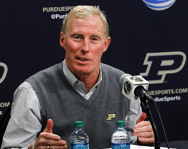 FILE - In this Nov. 25, 2012, file photo, Purdue athletic director Morgan Burke speaks during a news conference in West Lafayette, Ind. Burke, the longest serving athletic director in Purdue history, died at his home Monday, June 15, 2020, after battling a rare disease for the last year. He was 68. University officials said in a statement Burke had been diagnosed with amyloidosis, an ailment caused by an the build-up of an abnormal protein in the body's organs. (John Terhune/Journal & Courier via AP, File)