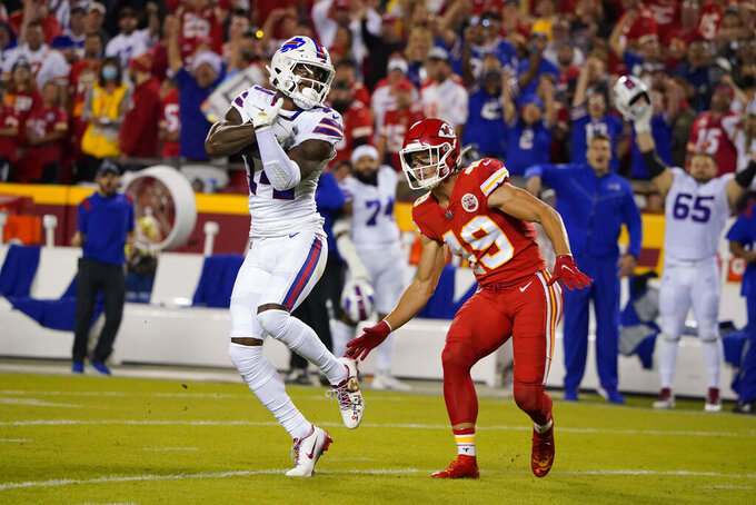Buffalo Bills wide receiver Stefon Diggs, left, catches a pass for a first down as Kansas City Chiefs safety Daniel Sorensen (49) defends during the first half of an NFL football game Sunday, Oct. 10, 2021, in Kansas City, Mo. (AP Photo/Ed Zurga)