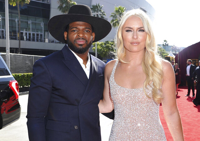 """FILE - In this July 10, 2019 file photo, P.K. Subban, left, of the New Jersey Devils, and Lindsey Vonn arrive at the ESPY Awards at Microsoft Theater in Los Angeles. Vonn popped the question to hockey star Subban. """"Merry Christmas and happy holidays everyone!! On our 2 year anniversary, in a """"non traditional"""" move, I asked PK to marry me and he said, Yes,"""