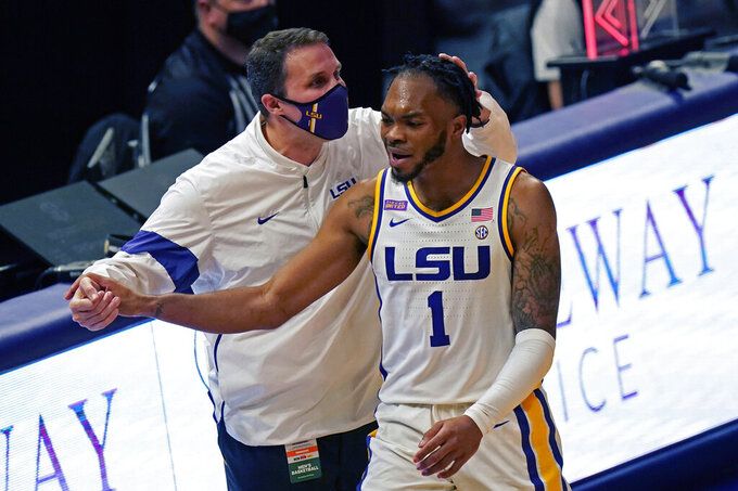 LSU head coach Will Wade congratulates guard Ja'Vonte Smart (1) during a substitution in the second half of an NCAA college basketball game against Tennessee in Baton Rouge, La., Saturday, Feb. 13, 2021. (AP Photo/Gerald Herbert)