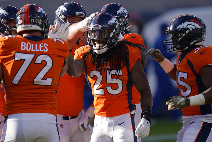 Denver Broncos running back Melvin Gordon (25) celebrates his touchdown against the Miami Dolphins during the first half of an NFL football game, Sunday, Nov. 22, 2020, in Denver. (AP Photo/David Zalubowski)