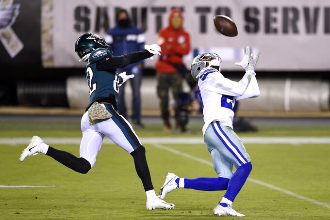 Dallas Cowboys' Trevon Diggs (27) intercepts a pass against Philadelphia Eagles' John Hightower (82) during the second half of an NFL football game, Sunday, Nov. 1, 2020, in Philadelphia. (AP Photo/Derik Hamilton)