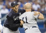 New York Yankees manager Aaron Boone holds Brett Gardner back from getting at home plate umpire Chris Segal after a called third strike during the fourth inning of a baseball game against the Toronto Blue Jays on Friday, Aug. 9, 2019, in Toronto. (Fred Thornhill/The Canadian Press via AP)
