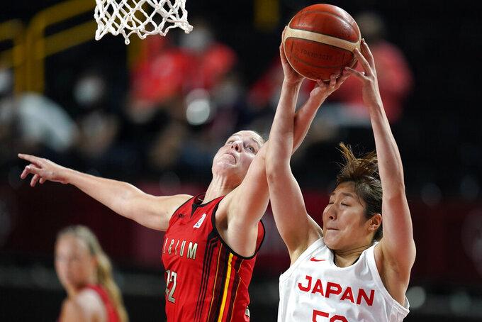 Belgium's Jana Raman (42) battles for a rebound with Japan's Yuki Miyazawa, right, during a women's basketball quarterfinal round game at the 2020 Summer Olympics, Wednesday, Aug. 4, 2021, in Saitama, Japan. (AP Photo/Charlie Neibergall)