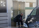 A security guard sits on the entrance to the Saudi Arabia consulate in Istanbul, marking the two-year anniversary of slain Saudi journalist Jamal Khashoggi's death, Friday, Oct. 2, 2020. The gathering was held outside the consulate building, starting at 1:14 p.m. (1014 GMT) marking the time Khashoggi walked into the building where he met his demise. (AP Photo/Emrah Gurel)