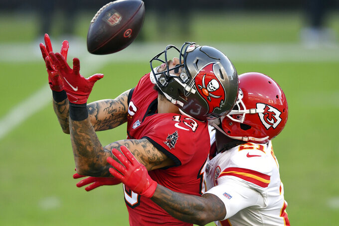 Tampa Bay Buccaneers wide receiver Mike Evans (13) can't hang onto a pass as he is held by Kansas City Chiefs cornerback Bashaud Breeland (21) during the first half of an NFL football game Sunday, Nov. 29, 2020, in Tampa, Fla. (AP Photo/Jason Behnken)