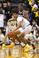 Missouri guard Dru Smith, left, dribbles around Texas A&M guard Wendell Mitchell, right, during the first half of an NCAA college basketball game Tuesday, Jan. 21, 2020, in Columbia, Mo. (AP Photo/L.G. Patterson)