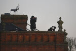 Security forces are positioned on the roof of the Grove hotel and resort where NATO leaders are meeting in Watford, Hertfordshire, England, Wednesday, Dec. 4, 2019. As NATO leaders meet and show that the world's biggest security alliance is adapting to modern threats, NATO Secretary-General Jens Stoltenberg is refusing to concede that the future of the 29-member alliance is under a cloud. (AP Photo/Frank Augstein)