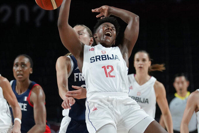 Serbia's Yvonne Anderson (12) is fouled by France's Marine Johannes (23) during a women's basketball bronze medal game at the 2020 Summer Olympics, Saturday, Aug. 7, 2021, in Saitama, Japan. (AP Photo/Eric Gay)