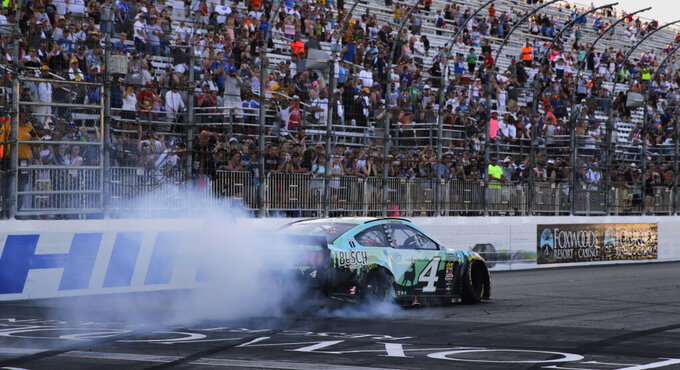 Kevin Harvick smokes his tires for fans after winning a NASCAR Cup Series auto race at New Hampshire Motor Speedway in Loudon, N.H., Sunday, July 21, 2019. (AP Photo/Charles Krupa)