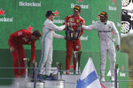 Ferrari driver Charles Leclerc of Monaco, second right, celebrates with third placed Mercedes driver Lewis Hamilton of Britain, right, and second place Mercedes driver Valtteri Bottas of Finland, second left on podium after winning the Formula One Italy Grand Prix at the Monza racetrack, in Monza, Italy, Sunday, Sept. 8, 2019. (AP Photo/Luca Bruno)