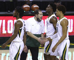 Baylor head coach Scott Drew congratulates Baylor guard MaCio Teague (31) during a time out in the second half of an NCAA college basketball game against Iowa State, Tuesday, Feb. 23, 2021, in Waco, Texas. (AP Photo/Jerry Larson)