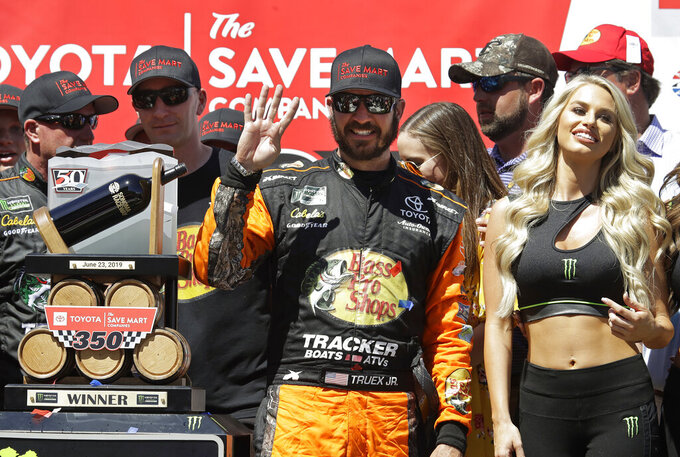 Martin Truex Jr., center, celebrates after winning a NASCAR Sprint Cup Series auto race Sunday, June 23, 2019, in Sonoma, Calif. (AP Photo/Ben Margot)