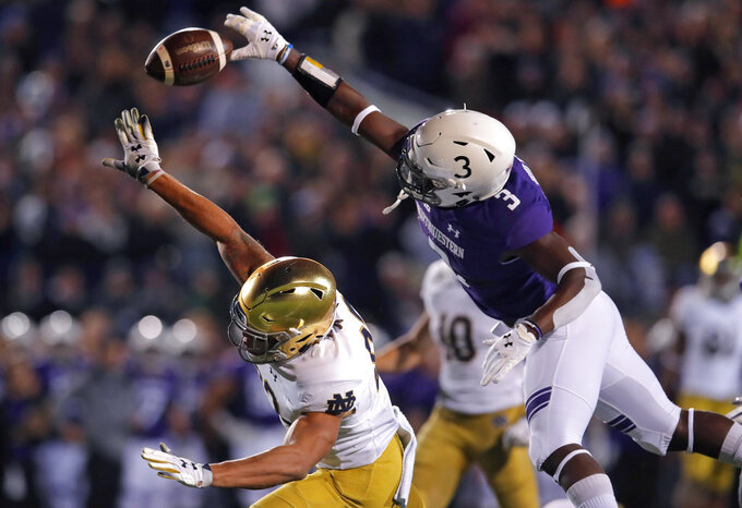 Northwestern's Trae Williams, right, breaks up a pass intended for Notre Dame's Chase Claypool during the first half of an NCAA college football game Saturday, Nov. 3, 2018, in Evanston, Ill. (AP Photo/Jim Young)