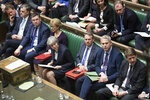 Britain's Prime Minister Theresa May, center front row, in the House of Commons, London, Wednesday March 13, 2019. In a tentative first step toward ending months of political deadlock, British lawmakers voted Wednesday to block the country from leaving the European Union without a divorce agreement, triggering an attempt to delay that departure, currently due to take place on March 29. (Jessica Taylor/UK Parliament via AP)